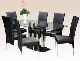 black marble base steel column supports table with clear glass san