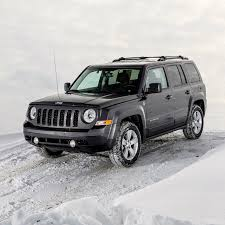jeep patriot black rims off road in the snow with jeep