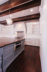 white kitchen cabinets with wood beams ceiling beams hardwood island wood kitchen cabinets new