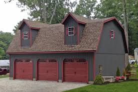 Gambrel Style House by Prefab Four Car Garage With Massive Storage Space