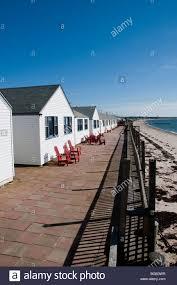 pilgrims beach beach bungalows shut for the winter stock photo