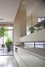 kitchen near clear kitchen cabinet near mirrored storage door near