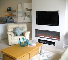 television over fireplace television over electric inset fire thornwood fireplaces