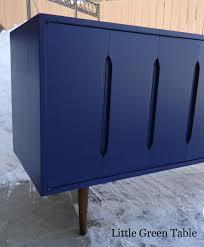 deep blue sideboard little green table