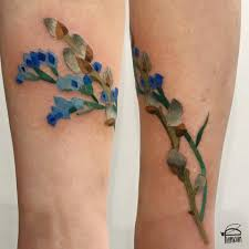 flower tattoos on forearm illustrative statice and willow flower tattoo on the forearm