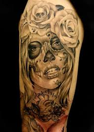 collection of 25 sparkling roses and skull tattoos on sleeve