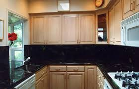 dark colored cabinets in kitchen white cabinets backsplash ceramic