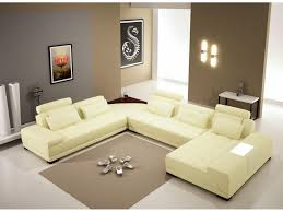 l shaped brown sofa with cushions also rustic style of concrete