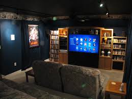 home theater unit furniture grey theater wall with black screen and brown wooden shelving unit