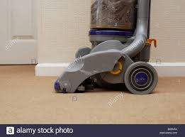Dyson Vaccume Cleaners Dyson Vacuum Cleaner On Lounge Carpet With Dust And Dirt Visible