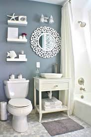 beach themed bathroom decor theme decorating ideas vintage look small and narrow bathroom spaces with beach inspired theme diy wooden vanity towel rack storage under round mirror