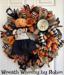 halloween deco mesh wreath in tan orange and black with pumpkin