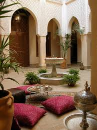 moroccan interiors poufs and luxurious silk throw pillows intricate tile work are a