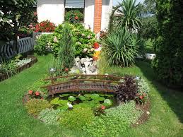 outdoor decorative pond using cute wooden bridge for small garden