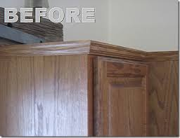 molding and side panel to update kitchen cabinets for the home