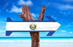 Salvadoran Flag El Salvador Flag Sign With Arrow On Beach Background Stock Photo