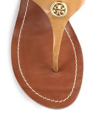 lexus logo earrings tory burch cameron logo leather thong wedge sandals in brown lyst