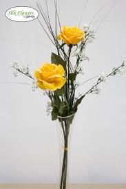 yellow roses u0026 gypsophilia in glass vase