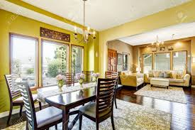house with open floor plan bright yellow dininig room with wooden