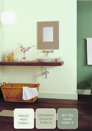 strike a balance in your bathroom design by combining green hues