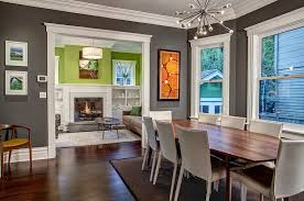 contemporary firework chandelier above wooden lacquered dining