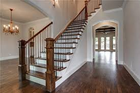 traditional staircase with crown molding hardwood floors in fort