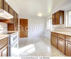 white kitchen cabinets with tile floor white kitchen room with windows tile floor brown storage combination and white appliances