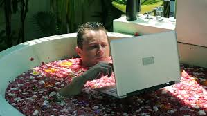 laptop bathtub man working on laptop and lying in the bath stock footage video