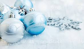 silver and blue balls with sparkle and snow stock photo