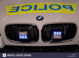 blue light on car front of bmw police car with its blue lights on bordon hshire