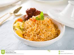 biryani indian cuisine biryani rice or briyani rice curry chicken and salad tradition