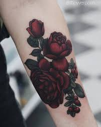 illustrative red rose tattoo on the left inner forearm tattoo
