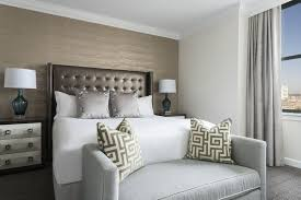 one bedroom suite the ritz carlton philadelphia executive suite bedroom with night stand and window with city views