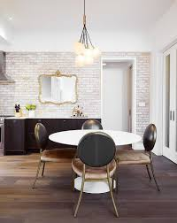 white round dining table with brown round back leather chairs