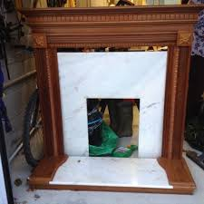 cherry wood fireplace with marble insert in plymouth devon