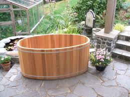 Chofu Wood Stove by 2 Person Oval Soaking Tub 2 Permaculture Village Pinterest