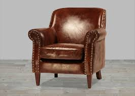 finished vintage leather club chair with antique brass nailheads
