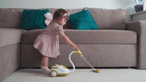Toy Vaccum Cleaner Cute Little Baby Using Toy Vacuum Cleaner In Room Stock