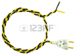 electric plug with yellow black wire twisted in a spiral stock