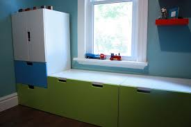 modern under window storage cabinet in lovely paint color