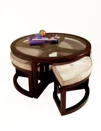 round grey fabric ottoman coffee table with four wooden legs and