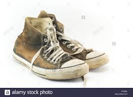 dirty pair old and dirty pair of sneakers on white stock photo royalty free