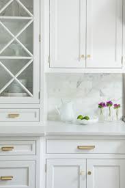 antique white kitchen cabinets brass white kitchen cabinets brass handles and knobs marble tile