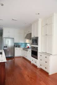 what to put on top of kitchen wall cabinets this may be an idea use wall cabinets sitting on top of