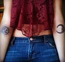 black moon and sun on arm tattoomagz
