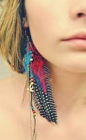 mr t feather earrings 30 best assymetrial and mismatched earring designs images on