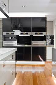 modern kitchen oven kitchen wooden floor ceiling light black kitchen cabinet white
