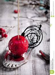 halloween candy apple sticks halloween black and red caramelized apples stock photo image