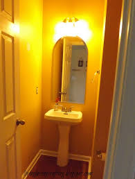 kids bathroom design ideas yellow wall paint decorting wtih wall light above mirror without