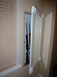 in wall gun cabinet hidden wall gun safe mirror mirror with hidden storage featuring